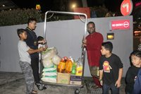Staff of Hotel Granada assist in loading the necessities into the chartered bus