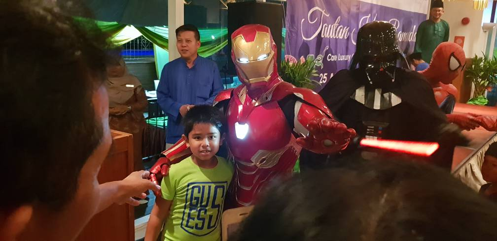 The kids enjoy photo moments with Ironman